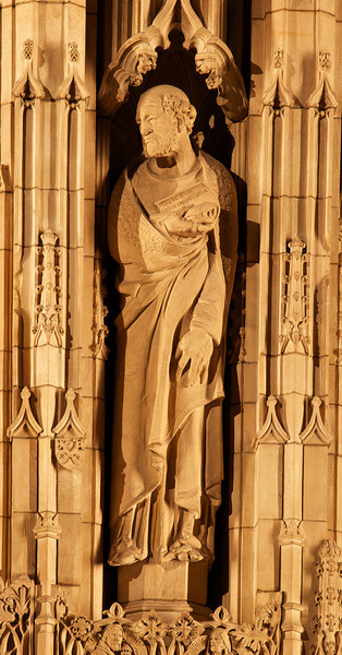 "Saint Thomas Church Reredos Statue of Saint Peter Shaped by Lee Lawrie<br /> <br /> It is difficult to make out details of the spectacular Saint Thomas Church reredos, even from the closest pews. To provide more detail, I used a telephoto lens at 320 mm to capture the great detail of the statues. This is Saint Peter.<br /> <br /> Bertram Grosvenor Goodhue was responsible for the theme and figures and won the American Institute of Architects' gold medal in 1925 for this effort. Sculptor Lee Lawrie shaped the figures' appearances, reflecting the individual personalities. Goodhue designed the church with Ralph Adams Cram. The carvings were executed in Boston from Dunville stone from Downsville, Wisconsin. When illuminated, the stone assumes the cast of ivory, according to ""A Walking Tour of Saint Thomas Church."""