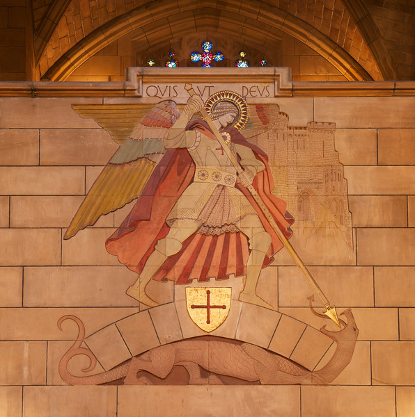 """Saint Thomas Church World War I Memorial by Lee Lawrie <br><br> At the top is the Archangel Michael, who drives his lance into the dragon. Below is relief of American soldiers going from America (represented by Saint Thomas Church) to France (represented by Rheims Catheral). According to a Latin to English translator I found on the web, Quis Ut Deus means """"Anyone to God.""""  <br><br> Lee Lawrie (1877-1963) was one of the foremost architectural sculptors and a key figure in the American art scene preceding World War II, according to <a href=""""http://en.wikipedia.org/wiki/Lee_Lawrie """">Wikipedia. </a>  He produced over 300 commissions in styles ranging from Modern Gothic, Beaux-Arts Classicism and finally into Moderne or Art Deco. He worked on details on the Nebraska State Capitol building in Lincoln, Nebraska and some of the architectural sculpture and, his most prominent work, the free-standing bronze Atlas (installed 1937) at New York City's Rockefeller Center.  <br><br> Lawrie collaborated with architects Ralph Adams Cram and Bertram Goodhue that brought him widespread acclaim as one of the greatest architectural sculptors in America. Lawrie continued to work with Goodhue after the breakup of the Cram, Goodhue firm in 1914. After Goodhue's premature death in 1924, Lawrie continued to work with his successors. Lawrie's collaborations with Goodhue are arguably the most highly developed example of architectural sculpture in American architectural history according to Wikipedia. <br><br> After Goodhue's death, Lawrie went on to produce important and highly visible work under Raymond Hood at Rockefeller Center in New York City, which included the Atlas in collaboration with Rene Paul Chambellan. The statue is 45 feet tall with a 15-foot figure of Atlas supporting an armillary sphere. Above the entrance to 30 Rockeller Plaza is Lawrie's Wisdom, an Art Deco piece and one of the most visible works in the complex.  <br><br> Other Lawrie works include: <br><br> •Allegorical rel"""