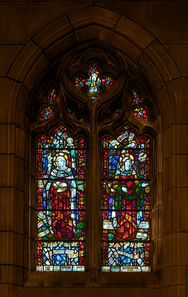 """Longsuffering and Peace (1930) Stained Glass Window by James Humphries Hogan of James Powell & Sons (Whitefriars), Ltd. <br><br> This window is in the Chantry Chapel also known as The Lady Chapel, which is dedicated to Our Lady, Saint Mary the Virgin. There are four windows in the chapel-all in honor of women in the Scriptures. One window was completed in 1929 and the other three in 1930. This window is Longsuffering and Peace. On the left side, which represents Longsuffering, is Dorca and Phebe represents Peace on the right side. The four windows were made possible by donations from the Burden family. Thanks to  David Daniel at Saint Thomas for information on the windows. <br><br> James Humphries Hogan (1883-1948) designed stained glass windows at Saint Thomas including this wondow. He was a noted stained glass artist for James Powell & Sons (Whitefriars), Ltd. of London from age 14 until his death in 1948. He made windows for many of England's churches including the 100 foot high central windows of Liverpool Cathedral. Some consider the windows at Saint Thomas to be some of the finest designs. <br><br> The firm of James Powell and Sons, also known as Whitefriars Glass, was an English glassmaker and stained glass window manufacturer. The company started in the 17th century but became well known as a result of the 19th century Gothic Revival. In 1962 the company name was changed back to Whitefriars Glass Ltd. It specialized in freeform glass ware until Caithness Glass purchased the firm in 1981. See <a href=""""http://en.wikipedia.org/wiki/James_Humphries_Hogan"""">Wikpedia</a> for more detail.  <br><br> In 2007, conservation began on the windows. It required three years and $20 million to restore the 9 million pieces of glass. The largest windows each required 4,500 man hours, the labor of one artisan for two and a half years. See the <a href=""""http://www.saintthomaschurch.org/about/glass"""">Saint Thomas website</a> and <a href=""""http://www.nytimes.com/2008/04/15/arts/design"""
