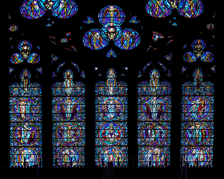 """The Great Western Rose Stained Glass Window by Charles Connick <br><br> <a href=""""http://www.csvf.org/Architecture-M.html"""">The church website</a> provides a very detailed description of the Great Western Rose Stained Glass Window by Charles Connick. I copied material from the website describing the individual panels. The first part starts at the left circle in the middle of the photo and goes from left to right.  <br><br> At the bottom are the 15 Mysteries of the Rosary: <br><br> The Glorious Mysteries start on the left:  1) The Resurrection – Jesus conquers death by rising to a new and more glorious life. 2) The Ascension – Jesus ascends to the Father. 3) The Descent of the Holy Spirit – The Holy Spirit comes down upon the disciples and Mary at Pentecost. 4) The Assumption of Mary – The Mother of God is taken up, body and soul, to heaven. 5) The Coronation of Mary – Mary is given a share in Christ's sovereignty over all things.  <br><br> In the middle tier are the Sorrowful Mysteries, from left to right:  6) The Agony in the Garden – Jesus sweats blood as he prepares to accept his death on the cross. 7) The Scourging of Jesus at the Pillar – Jesus' body is whipped and beaten. 8) The Crowning with Thorns – Jesus is cruelly mocked and humiliated by soldiers who crown him with thorns and bow before him. 9) The Carrying of the Cross – Jesus hauls the wood on which he will die to Calvary. 10) The Crucifixion – Jesus is nailed to the cross and dies for our sins. <br><br> On the bottom, from left to right, are the five Joyful Mysteries: <br><br> 11) The Annunciation – Mary humbly accepts the call delivered by the angel to be the mother of the Savior. 12) The Visitation – Mary is recognized as mother of the Savior by her cousin Elizabeth. 13) The Nativity – Jesus is born. 14) The Presentation of the Lord – Jesus is presented in the Temple and prophecies are made about the path of his life. 15) The Finding of Jesus in the Temple – The wisdom and knowledge of Jesus are manife"""