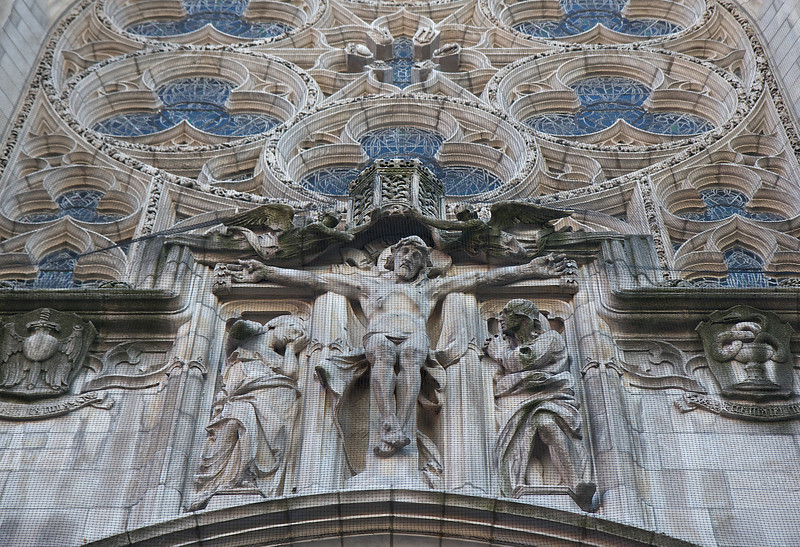 """Saint Vincent Ferrer Church, The Crucifixion by Lee Lawrie <br><br> Over the front entrance of Saint Vincent Ferrer church is a striking stone carving (a masterpiece according to <a href=""""http://www.fordham.edu/halsall/medny/mchale.asp"""">a Fordham University website on Medieval Architecture</a>) of the Crucifixion by Lee Lawrie (1877-1963). Architect Bertram Goodhue created an extremely new and unique design by placing the crucifixion statue outside the church, and there are few examples to this day.  <br><br> Lawrie was one of the foremost architectural sculptors and a key figure in the American art scene preceding World War II, according to <a href=""""http://en.wikipedia.org/wiki/Lee_Lawrie """">Wikipedia. </a>  He produced over 300 commissions in styles ranging from Modern Gothic, Beaux-Arts Classicism and finally into Moderne or Art Deco. He worked on details on the Nebraska State Capitol building in Lincoln, Nebraska and some of the architectural sculpture and, his most prominent work, the free-standing bronze Atlas (installed 1937) at New York City's Rockefeller Center.  <br><br> Lawrie collaborated with architects Ralph Adams Cram and Bertram Goodhue that brought him widespread acclaim as one of the greatest architectural sculptors in America. Lawrie continued to work with Goodhue after the breakup of the Cram, Goodhue firm in 1914. After Goodhue's premature death in 1924, Lawrie continued to work with his successors. Lawrie's collaborations with Goodhue are arguably the most highly developed example of architectural sculpture in American architectural history according to Wikipedia. <br><br> After Goodhue's death, Lawrie went on to produce important and highly visible work under Raymond Hood at Rockefeller Center in New York City, which included the Atlas in collaboration with Rene Paul Chambellan. The statue is 45 feet tall with a 15-foot figure of Atlas supporting an armillary sphere. Above the entrance to 30 Rockeller Plaza is Lawrie's Wisdom, an Art Deco piece"""