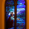 "The Second Reformed Church Christ, Gethsemane Window by John Berrian 1953 <br><br> From <a href=""http://www.secondreformed.org/stainedglass"">the church website:</a> <br><br> ""A news clipping from the dedication in 1953 stated: the window was ""an interpretation of (the painting) Christ Praying in the Garden"". Notice the moon and the stars in the Gethsemene window. They have no lead surrounding them! Lead lines in this location would not have given as pleasing an effect as this. The technique used to create the moon and stars is called acid etching of flashed glass.When  flashed glass is fabricated, a thin layer of color is fused to the surface of another piece of colored or clear glass (in this case, blue and white). The piece of flashed glass is masked to protect the areas not to be etched (the blue sky). Hydrofluoric acid is applied to remove one of the layers of the flashed glass and reveal the remaining color (the white of the moon)."""