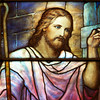 "The Second Reformed Church Christ, Christ, Knocking at the Door Window  From <a href=""http://www.secondreformed.org/stainedglass"">the church website:</a>  ""Our hearts need to be opened to let Jesus enter. The lantern Jesus carries is symbolic of His being the Light of the World. This lantern radiates its light on the darkest day!   This was a very popular theme of the period and Tiffany Studios installed many windows similar to this one. The studios utilized this basic design concept and customized it for other churches. A variation was the addition of a crown to Jesus' head. Colors would have been coordinated to harmonize with the surroundings in each location."" <br><br> Louis Comfort Tiffany (1848-1933) was one of America's most acclaimed artists and is most associated with the Art Nouveau and Aesthetic movements according to <a href=""http://en.wikipedia.org/wiki/Louis_Comfort_Tiffany"">Wikipedia.</a> He focused in the decorative arts and is best known for his work in stained glass. He was the son of Charles Lewis Tiffany (1812-1902), founder of Tiffany & Company. Lewis chose to pursue his own artistic interests rather than joining the family business.  <br><br> He began his career as a painter and traveled extensively through Europe. In the late 1870s, Tiffany turned his attention to decorative arts and interiors. In 1881, he did the interior design of the Mark Twain House in Hartford Connecticut. His most notable work was in 1862 when President Chester Arthur refused to move into the White House until it had been resorted, according to Wikipedia. He commissioned Tiffany, who had begun to make a name for himself for interior design work, to redo the state rooms. Tiffany worked on the East Room, Blue Room, Red Room, the State Dining Room, and the Entrance Hall.  <br><br> From  <a href=""http://www.metmuseum.org/toah/hd/tiff/hd_tiff.htm"">The Metropolitan Museum website:</a> ""By late 1892 or early 1893, Tiffany built a glasshouse in Corona, Queens, New York, and, with Arthur Nash, a skilled glassworker from Stourbridge, England, his furnaces developed a method whereby different colors were blended together in the molten state, achieving subtle effects of shading and texture. Recalling the Old English word fabrile (hand-wrought), Tiffany named the blown glass from his furnaces Favrile, a trademark that signified glass of hand-made and unique quality."" <br><br> ""Of all of Tiffany's artistic endeavors, leaded-glass brought him the greatest recognition. Tiffany and his early rival, John La Farge, revolutionized the look of stained glass, which had remained essentially unchanged since medieval times when craftsmen utilized flat panes of white and colored glass with details painted with glass paints before firing and leading. Tiffany and La Farge experimented with new types of glass and achieved a more varied palette with richer hues and greater density. By 1881, each had patented an opalescent glass, a unique American phenomenon that featured a milky, opaque, and sometimes rainbow-hued appearance with the introduction of light. Internally colored with variegated shades of the same or different hues, Tiffany's Favrile glass enabled craftsmen to substitute random tonal gradations, lines, textures, and densities inherent in the material itself for pictorial details."" <br><br> At its peak, his factory employed over 300 artisans. He was appointed as art director at Tiffany & Company upon his father's death in 1902. <br><br> Tiffany lived during the Gilded Age, a period of rapid church expansion; one source reports that there were 4,000 churches under contraction in the U.S. in the 1880s according to a recent <a href=""http://www.nytimes.com/2013/01/01/arts/design/louis-c-tiffany-works-at-museum-of-biblical-art.html?ref=louiscomforttiffany"">The New York Times article</a> on an exhibit of Tiffany's ecclesiastical work. There was a great demand for artists that could create great and inspiring stained glass windows, mosaics, rederos, and altars. Many churches turned to Tiffany to create such beautiful works. His work in New York churches include Saint Michaels, Advent Lutheran, Saint Ignatius Loyola, Temple Emmanu-El, Church of the Incarnation, Holy Trinity Lutheran Church, Eldridge Street Synagogue; in New Jersey, numerous windows are in Second Reformed Church of Hackensack. <br><br> After fire destroyed their first church, The Second Reform Church in Hackensack, New Jersey contacted Tiffany requesting windows depicting events in the life of Christ and contracted Tiffany Studios for five windows, according to <a href=""http://www.secondreformed.org/clientimages/42874/stainedglasswindows/stained%20glass%20window%20info.pdf"">the church website.</a> The church also contracted Duffner & Kimberly Co. for one window.  The installation of these windows was competed before the dedication ceremony in 1909.  <br><br> From the church website: <br><br> ""The New York Times (May 4, 1979) wrote: ""Some of Tiffany's favorite windows are in the Second Reformed Church in Hackensack ,... Tiffany frequently visited there with clients in tow, using  the visit to help them select appropriate design for their purposes."" For each installation, the design was customized as the client requested and reworked to fit the window's opening size and shape requirements. Colors were coordinated to harmonize with the surroundings in each location."""