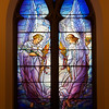 "The Second Reformed Church Goodness and Mercy Angels Window <br><br> From <a href=""http://www.secondreformed.org/stainedglass"">the church website:</a> <br><br> ""Surely goodness and mercy shall follow me all the days of my life and I will dwell in the house of the Lord forever."" Psalm 23:6  <br><br> ""Tiffany incorporated the metal strips into the design as outlines... instead of using the cames, or frames, at regular intervals, as glass makers had done for centuries. Seen here, the lead cames follow the gradual lines of the angel's flowing robes and the clouds."" <br><br> Louis Comfort Tiffany (1848-1933) was one of America's most acclaimed artists and is most associated with the Art Nouveau and Aesthetic movements according to <a href=""http://en.wikipedia.org/wiki/Louis_Comfort_Tiffany"">Wikipedia.</a> He focused in the decorative arts and is best known for his work in stained glass. He was the son of Charles Lewis Tiffany (1812-1902), founder of Tiffany & Company. Lewis chose to pursue his own artistic interests rather than joining the family business.  <br><br> He began his career as a painter and traveled extensively through Europe. In the late 1870s, Tiffany turned his attention to decorative arts and interiors. In 1881, he did the interior design of the Mark Twain House in Hartford Connecticut. His most notable work was in 1862 when President Chester Arthur refused to move into the White House until it had been resorted, according to Wikipedia. He commissioned Tiffany, who had begun to make a name for himself for interior design work, to redo the state rooms. Tiffany worked on the East Room, Blue Room, Red Room, the State Dining Room, and the Entrance Hall.  <br><br> From  <a href=""http://www.metmuseum.org/toah/hd/tiff/hd_tiff.htm"">The Metropolitan Museum website:</a> ""By late 1892 or early 1893, Tiffany built a glasshouse in Corona, Queens, New York, and, with Arthur Nash, a skilled glassworker from Stourbridge, England, his furnaces developed a method whereby different colors were blended together in the molten state, achieving subtle effects of shading and texture. Recalling the Old English word fabrile (hand-wrought), Tiffany named the blown glass from his furnaces Favrile, a trademark that signified glass of hand-made and unique quality."" <br><br> ""Of all of Tiffany's artistic endeavors, leaded-glass brought him the greatest recognition. Tiffany and his early rival, John La Farge, revolutionized the look of stained glass, which had remained essentially unchanged since medieval times when craftsmen utilized flat panes of white and colored glass with details painted with glass paints before firing and leading. Tiffany and La Farge experimented with new types of glass and achieved a more varied palette with richer hues and greater density. By 1881, each had patented an opalescent glass, a unique American phenomenon that featured a milky, opaque, and sometimes rainbow-hued appearance with the introduction of light. Internally colored with variegated shades of the same or different hues, Tiffany's Favrile glass enabled craftsmen to substitute random tonal gradations, lines, textures, and densities inherent in the material itself for pictorial details."" <br><br> At its peak, his factory employed over 300 artisans. He was appointed as art director at Tiffany & Company upon his father's death in 1902. <br><br> Tiffany lived during the Gilded Age, a period of rapid church expansion; one source reports that there were 4,000 churches under contraction in the U.S. in the 1880s according to a recent <a href=""http://www.nytimes.com/2013/01/01/arts/design/louis-c-tiffany-works-at-museum-of-biblical-art.html?ref=louiscomforttiffany"">The New York Times article</a> on an exhibit of Tiffany's ecclesiastical work. There was a great demand for artists that could create great and inspiring stained glass windows, mosaics, rederos, and altars. Many churches turned to Tiffany to create such beautiful works. His work in New York churches include Saint Michaels, Advent Lutheran, Saint Ignatius Loyola, Temple Emmanu-El, Church of the Incarnation, Holy Trinity Lutheran Church, Eldridge Street Synagogue; in New Jersey, numerous windows are in Second Reformed Church of Hackensack. <br><br> After fire destroyed their first church, The Second Reform Church in Hackensack, New Jersey contacted Tiffany requesting windows depicting events in the life of Christ and contracted Tiffany Studios for five windows, according to <a href=""http://www.secondreformed.org/clientimages/42874/stainedglasswindows/stained%20glass%20window%20info.pdf"">the church website.</a> The church also contracted Duffner & Kimberly Co. for one window.  The installation of these windows was competed before the dedication ceremony in 1909.  <br><br> From the church website: <br><br> ""The New York Times (May 4, 1979) wrote: ""Some of Tiffany's favorite windows are in the Second Reformed Church in Hackensack ,... Tiffany frequently visited there with clients in tow, using  the visit to help them select appropriate design for their purposes."" For each installation, the design was customized as the client requested and reworked to fit the window's opening size and shape requirements. Colors were coordinated to harmonize with the surroundings in each location."""