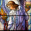 "The Second Reformed Church Goodness and Mercy Angels Window <br><br> From <a href=""http://www.secondreformed.org/stainedglass"">the church website:</a> <br><br> ""Surely goodness and mercy shall follow me all the days of my life and I will dwell in the house of the Lord forever."" Psalm 23:6  <br><br> ""Tiffany incorporated the metal strips into the design as outlines... instead of using the cames, or frames, at regular intervals, as glass makers had done for centuries. Seen here, the lead cames follow the gradual lines of the angel's flowing robes and the clouds."" <br><br> Louis Comfort Tiffany (1848-1933) was one of America's most acclaimed artists and is most associated with the Art Nouveau and Aesthetic movements according to <a href=""http://en.wikipedia.org/wiki/Louis_Comfort_Tiffany"">Wikipedia.</a> He focused in the decorative arts and is best known for his work in stained glass. He was the son of Charles Lewis Tiffany (1812-1902), founder of Tiffany & Company. Lewis chose to pursue his own artistic interests rather than joining the family business.  <br><br> He began his career as a painter and traveled extensively through Europe. In the late 1870s, Tiffany turned his attention to decorative arts and interiors. In 1881, he did the interior design of the Mark Twain House in Hartford Connecticut. His most notable work was in 1862 when President Chester Arthur refused to move into the White House until it had been resorted, according to Wikipedia. He commissioned Tiffany, who had begun to make a name for himself for interior design work, to redo the state rooms. Tiffany worked on the East Room, Blue Room, Red Room, the State Dining Room, and the Entrance Hall.  <br><br> From  <a href=""http://www.metmuseum.org/toah/hd/tiff/hd_tiff.htm"">The Metropolitan Museum website:</a> ""By late 1892 or early 1893, Tiffany built a glasshouse in Corona, Queens, New York, and, with Arthur Nash, a skilled glassworker from Stourbridge, England, his furnaces developed a method whereby different colors were blended together in the molten state, achieving subtle effects of shading and texture. Recalling the Old English word fabrile (hand-wrought), Tiffany named the blown glass from his furnaces Favrile, a trademark that signified glass of hand-made and unique quality."" <br><br> ""Of all of Tiffany's artistic endeavors, leaded-glass brought him the greatest recognition. Tiffany and his early rival, John La Farge, revolutionized the look of stained glass, which had remained essentially unchanged since medieval times when craftsmen utilized flat panes of white and colored glass with details painted with glass paints before firing and leading. Tiffany and La Farge experimented with new types of glass and achieved a more varied palette with richer hues and greater density. By 1881, each had patented an opalescent glass, a unique American phenomenon that featured a milky, opaque, and sometimes rainbow-hued appearance with the introduction of light. Internally colored with variegated shades of the same or different hues, Tiffany's Favrile glass enabled craftsmen to substitute random tonal gradations, lines, textures, and densities inherent in the material itself for pictorial details."" <br><br> At its peak, his factory employed over 300 artisans. He was appointed as art director at Tiffany & Company upon his father's death in 1902.  Tiffany lived during the Gilded Age, a period of rapid church expansion; one source reports that there were 4,000 churches under contraction in the U.S. in the 1880s according to a recent <a href=""http://www.nytimes.com/2013/01/01/arts/design/louis-c-tiffany-works-at-museum-of-biblical-art.html?ref=louiscomforttiffany"">The New York Times article</a> on an exhibit of Tiffany's ecclesiastical work. There was a great demand for artists that could create great and inspiring stained glass windows, mosaics, rederos, and altars. Many churches turned to Tiffany to create such beautiful works. His work in New York churches include Saint Michaels, Advent Lutheran, Saint Ignatius Loyola, Temple Emmanu-El, Church of the Incarnation, Holy Trinity Lutheran Church, Eldridge Street Synagogue; in New Jersey, numerous windows are in Second Reformed Church of Hackensack. <br><br> After fire destroyed their first church, The Second Reform Church in Hackensack, New Jersey contacted Tiffany requesting windows depicting events in the life of Christ and contracted Tiffany Studios for five windows, according to <a href=""http://www.secondreformed.org/clientimages/42874/stainedglasswindows/stained%20glass%20window%20info.pdf"">the church website.</a> The church also contracted Duffner & Kimberly Co. for one window.  The installation of these windows was competed before the dedication ceremony in 1909.  <br><br> From the church website: <br><br> ""The New York Times (May 4, 1979) wrote: ""Some of Tiffany's favorite windows are in the Second Reformed Church in Hackensack ,... Tiffany frequently visited there with clients in tow, using  the visit to help them select appropriate design for their purposes."" For each installation, the design was customized as the client requested and reworked to fit the window's opening size and shape requirements. Colors were coordinated to harmonize with the surroundings in each location."""
