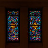 "Temple Emanu-El Stained Glass Windows <br><br> From a pdf file from the <a href=""http://www.emanuelnyc.org/simple.php/about_tour"">Temple Emanu-El website:</a>  <br><br> Located along the street level is a series of smaller stained-glass windows depicting noted synagogues from around the world. The window on the right depicts the Great Synagogue of Toledo, Spain-a Moorish-style synagogue built in the 12th century. See <a href=""http://en.wikipedia.org/wiki/Santa_Mar%C3%ADa_la_Blanca"">Wikipedia</a> for more detail on the Spanish Temple.  <br><br> In this photo, I was attracted by the beautiful light from the stained glass windows and the reflection off the marble columns on both sides of the windows."