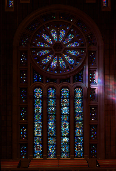 "Temple Emanu-El Rose Window by Oliver Smith <br><br> From a pdf file from the <a href=""http://www.emanuelnyc.org/simple.php/about_tour"">Temple Emanu-El website:</a>  <br><br> ""Most prominent of the stained-glass windows featured on the sanctuary's western façade is Oliver Smith's rose or wheel window, which is replete with numerical strategies that are a subtext of Jewish mysticism. Emanu-El's ""signature"" window is comprised of 12 panes (symbolic of the tribes of Israel) surrounding a six-pointed Magen David (or Star of David). Circling the rose are 36 small panes-36 being significant because of the Talmudic reference to 36 righteous men in each generation who are responsible for preserving the world; 36 also signifies ""double life"" in gematria (numerology of the Hebrew language and alphabet) because 2 X 18 = 36 and 18 is the numerical value of the Hebrew word chai, which means ""life."" The rose window was donated to the congregation in honor of Babette and Mayer Lehman by their children, who included New York Supreme Court Justice Irving Lehman (a former Emanu-El president) and New York Governor Herbert Lehman (the first Jewish governor of New York). <br><br> Caai likewise is symbolized in the 18 marquis-shaped panes that arch around the rose and four lancet windows (each of which have 10 panes). The 18 panes of the arch may suggest the Amidah, our 18-part daily prayer. The seven windows located at the top imitate the seven-branched menorahs on the bimah. The center high window of the seven was donated to the congregation by Florette Guggenheim-widow of Benjamin Guggenheim (who died aboard Titanic), mother of arts patron Peggy Guggenheim and daughter of Joseph Seligman (a member of the Seligman banking family and a long-time vice president of the congregation.""  <br><br> According to the <a href=""http://www.rodephsholom.com/index.php?option=com_content&view=article&id=159&Itemid=155"">Congregation Rodeph Sholom website, </a>  Oliver Smith was a master craftsman in the art of stained glass, most notably in the Arts and Crafts style. Smith's studio was in Bryn Athyn, Pennsylvania as early as 1929, possibly earlier. His windows are at the Princeton Chapel, Princeton, New Jersey; Clothier Memorial Hall, Swarthmore, Pennsylvania; and Temple B'nai Brith, Los Angeles. Additionally, Smith's paintings have been exhibited at the Corcoran Gallery of Art, Washington, D.C., the National Academy of Design and the Kennedy Gallery, both in New York City."
