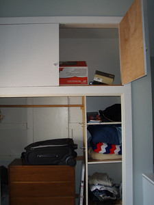 Large storage above the closet for out-of-season clothes, etc.  The panel in back of the bureau is, it turns out, a piece you pull off for access to an attic/crawlspace.