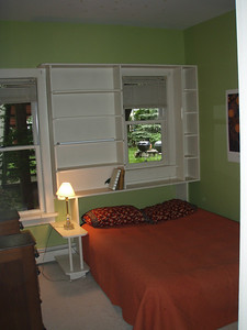 bedroom 1 - windows onto back yard, built-ins