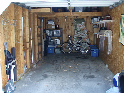 No basement, but the garage is nice - not insulated or heated, but lots of room for storage, outdoor gear, loft for more stuff.  Could prob stick a spare freezer out here too...