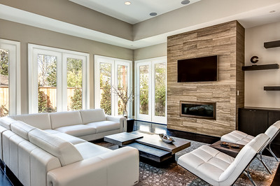 Modern White Leather Sofa with Stacked Stone Fireplace