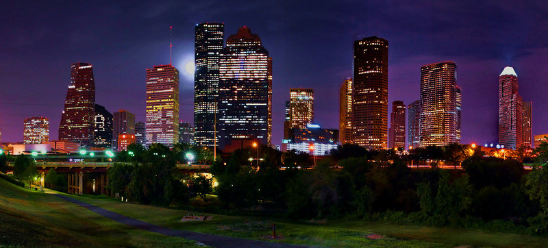 Houston downtown skyline with full moon; a panoramic view of the skyline in HDR it measures 12 X 24 and comes mounted on foam board and matted.  This photo sells for $100.