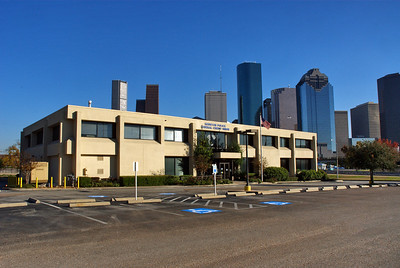 Houston Police Federal Credit Union building, Houston skyline in the background