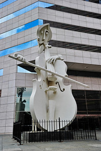 "A huge cellist tells everyone it's the ""Lyric Center""."