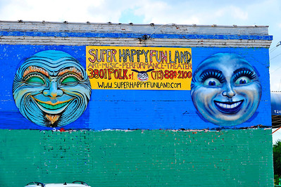 Driving down Polk St. I saw these two 3D faces advertising Super Happy Funland.