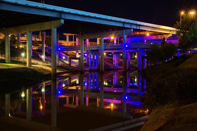 Buffalo Bayou in blue lights (behind Hobby Center)