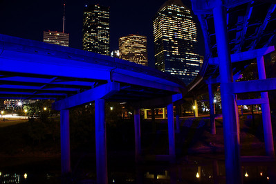 30 second time exposure creates the blue color to the freeway underpasses from the blue lights along the bayou