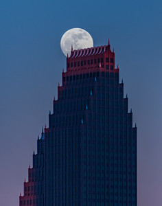 Moon atop Bank of America Building in downtown Houston