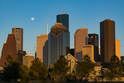 Moonrise over downtown Houston along Allen Parkway