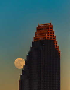 Moonrise along the edge of Bank of America building in downtown Houston