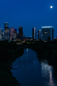 Blue sky at night with moonrise over Buffalo Bayou
