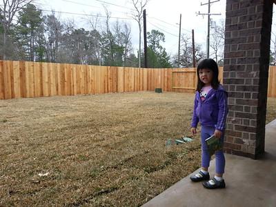Backyard grass and some kid
