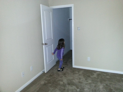 Madi looking in her closet