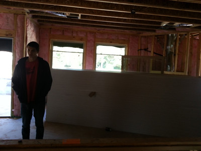 Living room from kitchen.  I guess they gettin ready to do some dry-wallin.