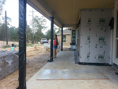 Back covered patio.  Those columns will get the stone, the thermo-ply will get brick.