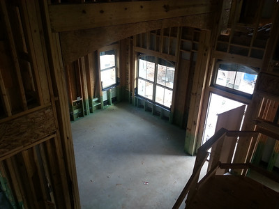 View of front/dining room and entry way from upstairs.  Note, arch.  There are lots of archways in this house.