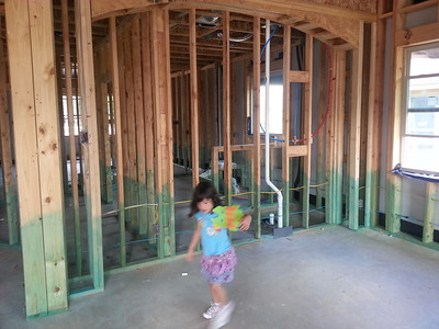 Madi in the front/dining room.  master bath beyond.