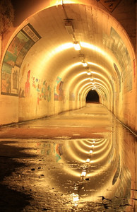 503 - This image is the tunnel from Los Trancos parking lot to the Beach Comber area.  There is a small pool of water at the entrace, The light reflection makes this image looks like a time warp, frame within frame within frame within ..., (Photographed by Honghai Ouyang)