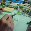 """Without delay, apply solder to 6"""" length of wire which has had acid flux applied. Here I'm using a 55W HAKKO soldering iron to apply the solder."""