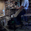 "Video of Foot Powered Table Saw<br /> This is to show my Foot Powered Table saw in use. Now to some it might appear that I am peddling backwards, if I were on a bicycle that would be the case, but this is a table saw and to cut properly the blade has to turn toward you to cut. I have found one advantage to peddling in this manner is that I don't have as much upper body movement as I have when I peddle as on a bicycle.<br /> <br />  The main accessories of the table saw when I use it are the different jigs I made. I have 6 different jigs to cut the 6 different pieces I use in making my craft. I made them out of angle iron and bar stock. They are adjustable for each piece they are designed to cut so that they will cut to a tolerance of .005 when they are set up right.<br /> <br /> You will always want to keep a sharp saw blade in this saw at all times or else you will run the risk of overheating the power supply and causing it to stop.<br /> <br /> An untested theory on the safety of this saw is that if you hit your finger, your feet stop.<br /> <br /> (For every revolution of my feet the blade turns 30 times, so when I peddle at 40 rpm I am getting 1200 rpm's on the blade. It also has 50 pounds of flywheel to get you over the top and bottom of your peddle stroke.)<br /> <br /> (To see a longer and slightly different video of this saw, click on this link;<br />  <a href=""http://www.youtube.com/watch?v=AAd5bAYsW-k"">http://www.youtube.com/watch?v=AAd5bAYsW-k</a> )"