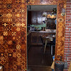 First Section of the Wall I did<br /> In the early 1980's I decided to put pieces on the wall on each side of the brickwork I put up behind the wood heating stove. I cut plywood to fit up where it was to go then took the plywood to the shop to put the pieces on. It took all of one winter to get the first half done. The next winter I got the part on the other side of the stove. None of the pictures are very good that I took then, or now. But you can see the color change that has occurred in the last 23 or24 years. I will put notes with numbers on the closer sections of the wall, then and now. It is not nearly as fine of workmanship as is on my latter work, but then that is to be expected, I would hope.