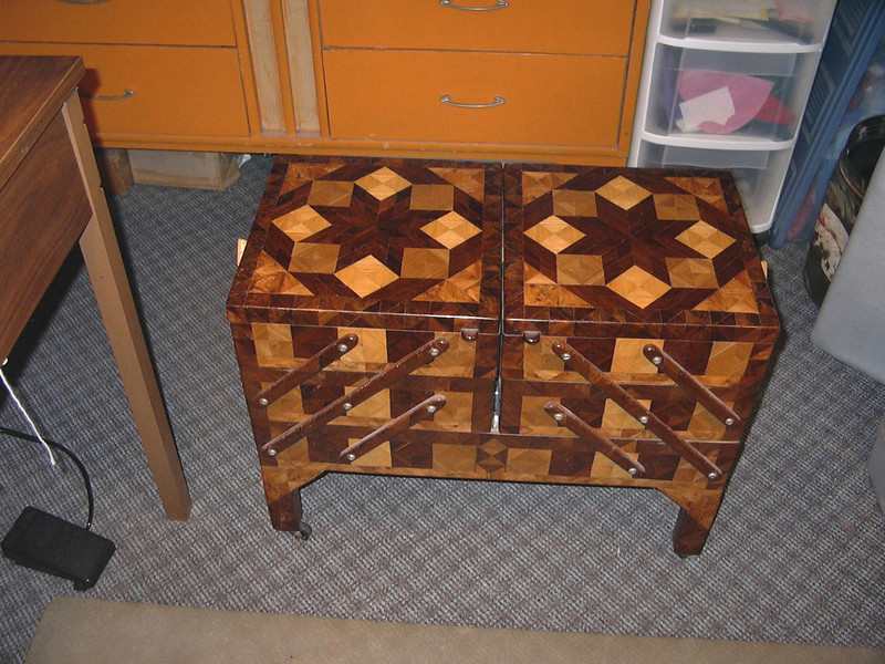 Kathy's Sewing Cabinet, 2007<br /> After making Marks Tool Chest I spent the next year making smaller boxes and maybe even seeing what I could do with a chessboard. In the fall of 1982 I started this Sewing Chest for my wife, Kathy. I got it finished up in the spring of 1983. I used Elm, Ash, Apple, Honduras Rosewood and Walnut on it by then I was into buying some of the exotic wood I could come across. The native wood I was cutting down myself. When the chest is fully open on both sides it is four and a half feet long and of course Kathy still has it.