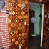 Second Section of the Wall I did<br /> In the early 1980's I decided to put pieces on the wall on each side of the brickwork I put up behind the wood heating stove. I cut plywood to fit up where it was to go then took the plywood to the shop to put the pieces on. It took all of one winter to get the first half done. The next winter I got the part on the other side of the stove. None of the pictures are very good that I took then, or now. But you can see the color change that has occurred in the last 23 or24 years. I will put notes with numbers on the closer sections of the wall, then and now. It is not nearly as fine of workmanship as is on my latter work, but then that is to be expected, I would hope.