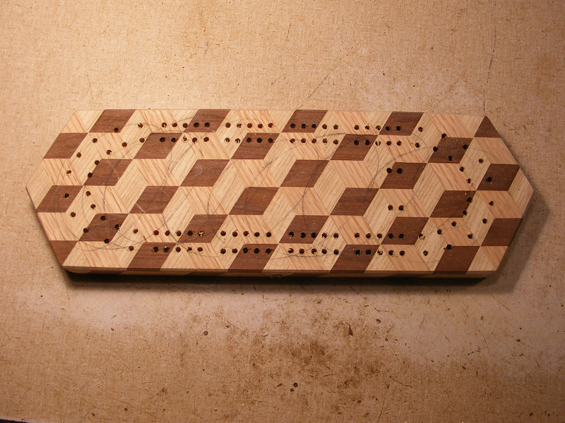 28 - Making a Tumbling Block Cribbage Board <br /> I end up with the holes looking like this.