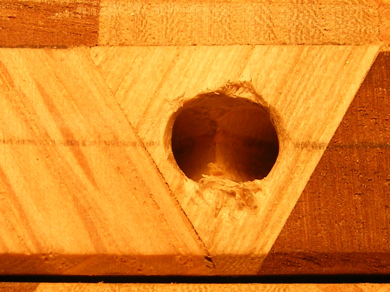 "30 - Making a Tumbling Block Cribbage Board <br /> A close look at the hole will look like this. You are looking at two ¼"" holes."