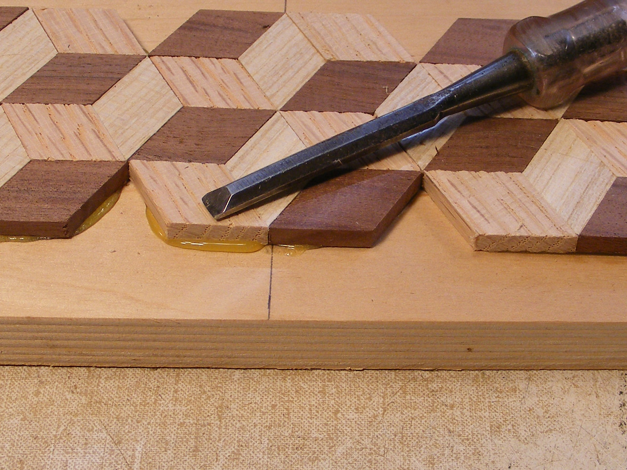 10 - Making a Tumbling Block Cribbage Board <br /> At this stage the glue will be hard enough that it won't be sticky.
