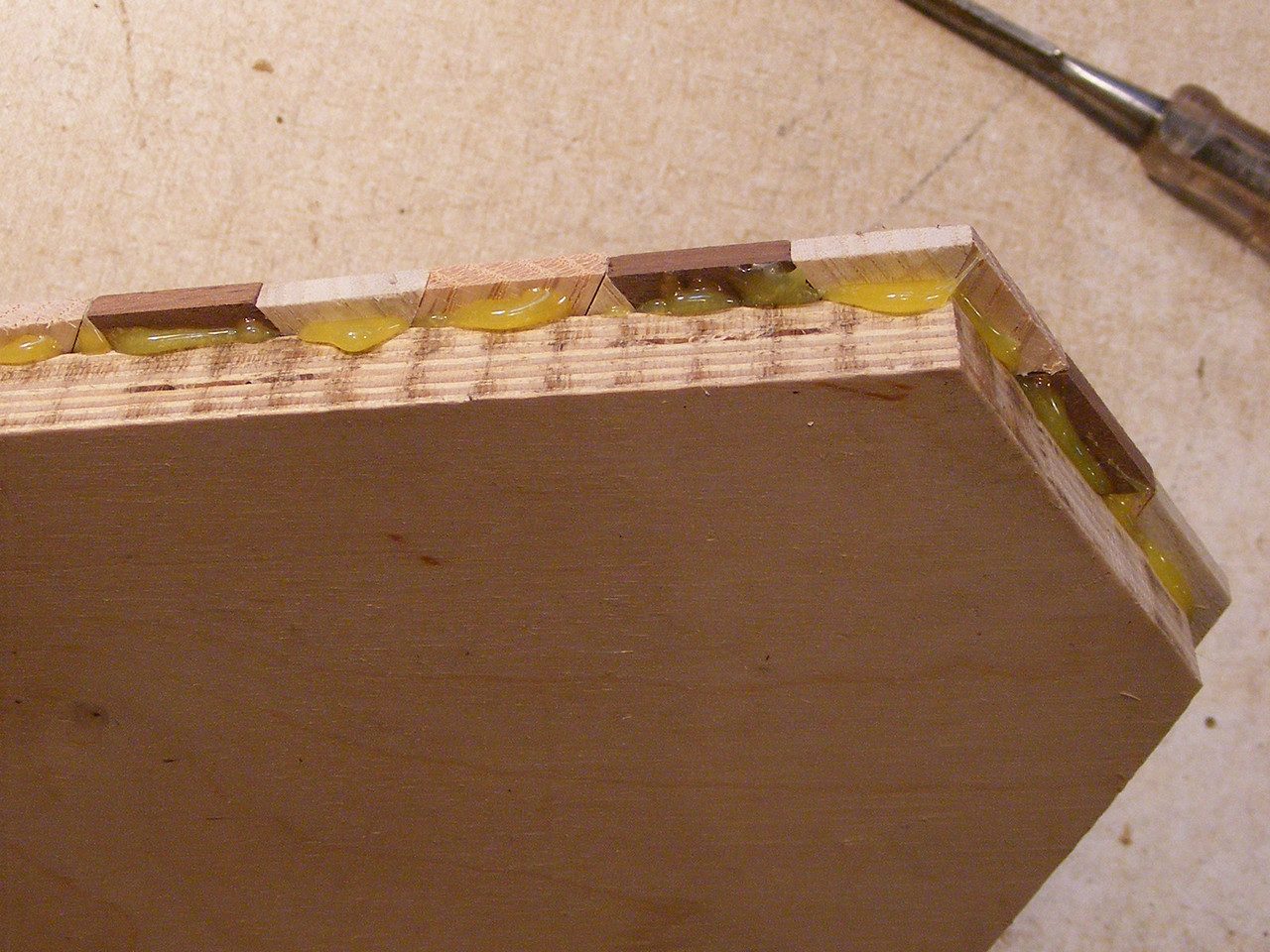 15 - Making a Tumbling Block Cribbage Board <br /> Then trim off the glue that has squeezed out.