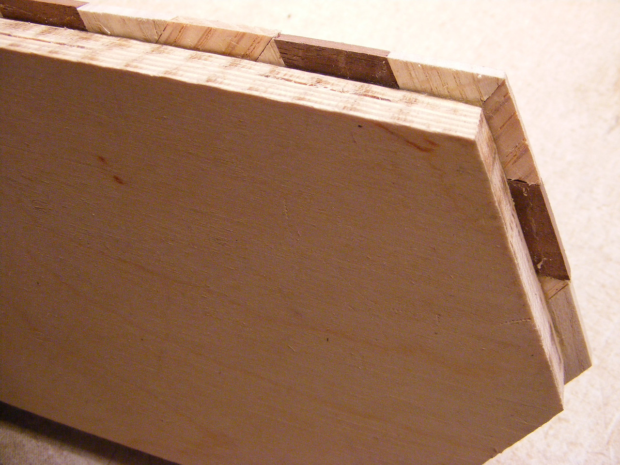 16 - Making a Tumbling Block Cribbage Board <br /> This leaves a clean square corner to glue the side pieces on.