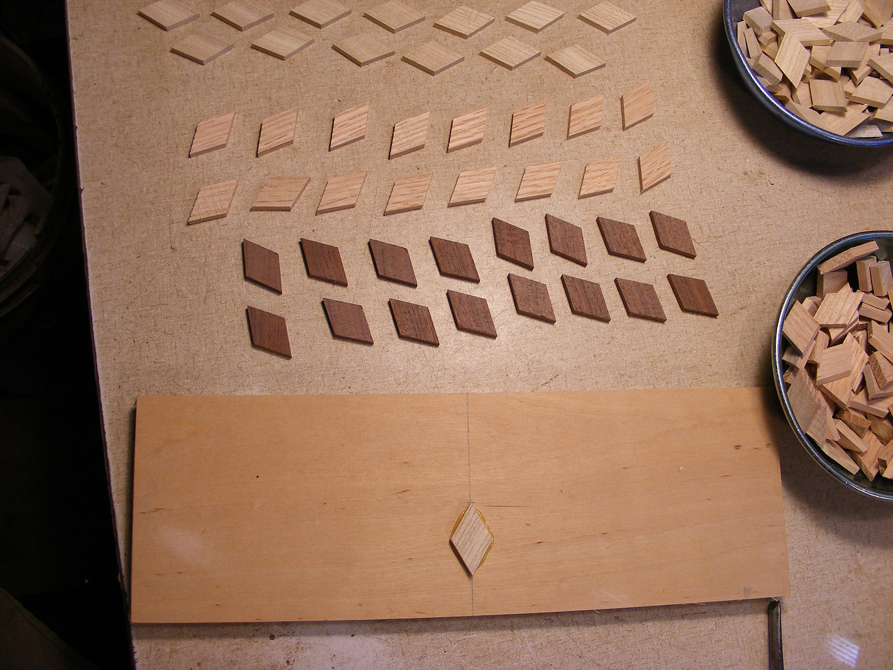 8 - Making a Tumbling Block Cribbage Board <br /> To help things go faster I will lay out some diamonds, the right way they are to go on, before I start to glue them on. For this picture I have the blank turned 90° from how I will be working by gluing the diamonds on.