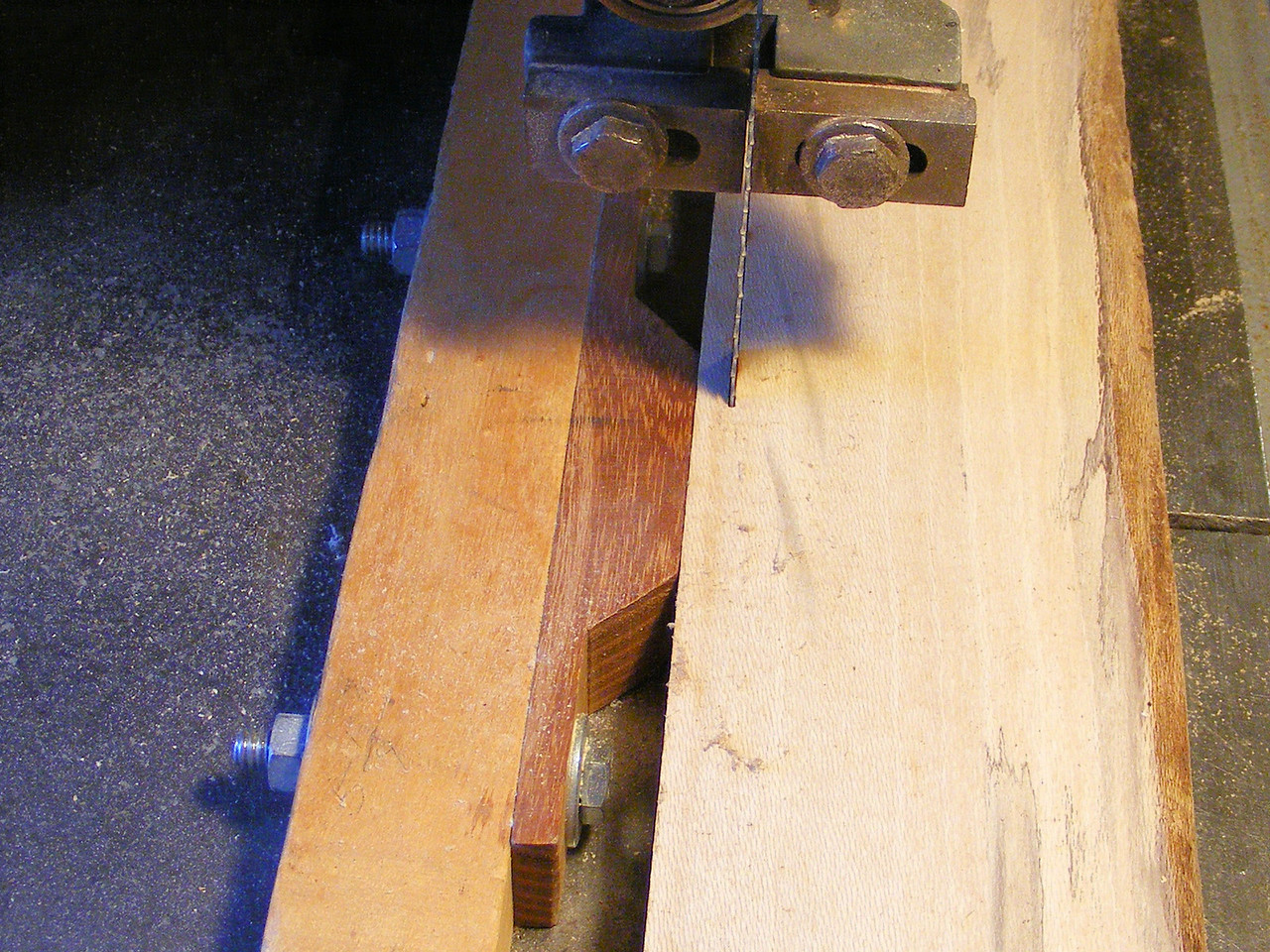 "1 - Making a Tumbling Block Cribbage Board <br /> I needed to make some more of my Tumbling Block Cribbage Boards and I needed more strips of different kinds of wood that I cut the pieces from. I put a short block of wood on the fence so if the board has any curve to it, the longer fence would make the strip have a thin part to it, the short block will let the strip keep that curve. When I cut the pieces, that slight curve will not be a factor. I want the whole strip to be .200 end to end. The pieces will then all be of a uniform thickness and I can know that I can get 4 strips of wood for every inch the starting board is wide. If I have a board 6"" wide I will end up with 24 strips from that board. I will cut my boards close to 24"" long and for my regular diamonds and triangles; I will get 20 diamonds and 28 triangles."