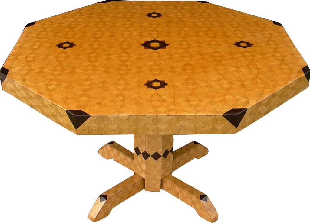 "8 Table Lg ASC Oak<br />  I call this my ""Large Oak ASC"" table. The pattern on this table is the ""Aunt Sukeys Choice"" quilt pattern. It is the same pattern that is on the ""Oak Square Box"". As you can see on the square box, 2 diamonds are on each corner. They form a star, when 4 of the patterns come together, as shows in the ""Close-up"". Out from the center I have 4 half size patterns that are the same size that is on my ""Oak Tiny Square Box"", twice as many pieces as would normally be in that area. The table stands 30"" tall and is 48"" wide. There are over 6000 pieces on the entire table. The pieces are used over the edge and onto the pedestal and feet of the table. The table is finished in its natural color with 6 or 8 coats of varnish. After the varnish hardens for at least a month, I level it and buff it to a high shine. The pieces are a bit over 3/16"" thick, glued onto a Baltic Birch base, so they hold up much better than a thin veneer.<br />      The type of wood is listed on the bottom of the table from the center out. On this table the wood is ""Satinwood"" from South America, ""Walnut"" from Missouri, ""Wenge"" from West Africa, ""Purpleheart"" from Central or South America, and ""Oak"" from Missouri.  <br />     I made this table in 2000 and got it finished in 2001. It is large table number 17. On the bottom I signed it, listed the wood, dated it and put the number of the table. As with everything I make I can find flaws in each item, be it box or table. It's not perfect but you'll look a long time to find a prettier table."