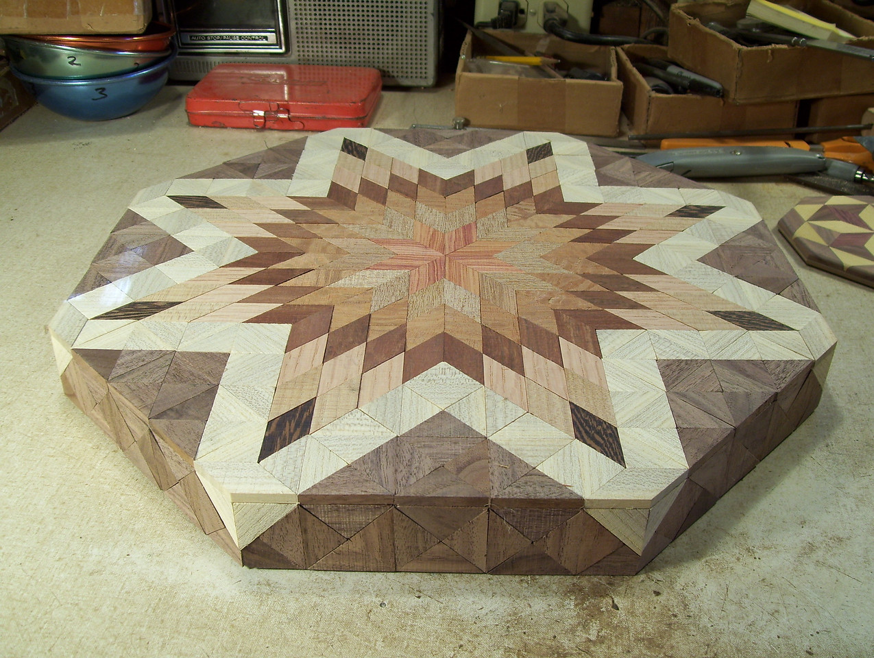 Making a Lazy Susan #47<br /> After getting the last two pieces glued on each corner, and the glue trimmed off it is ready to be sanded down even.