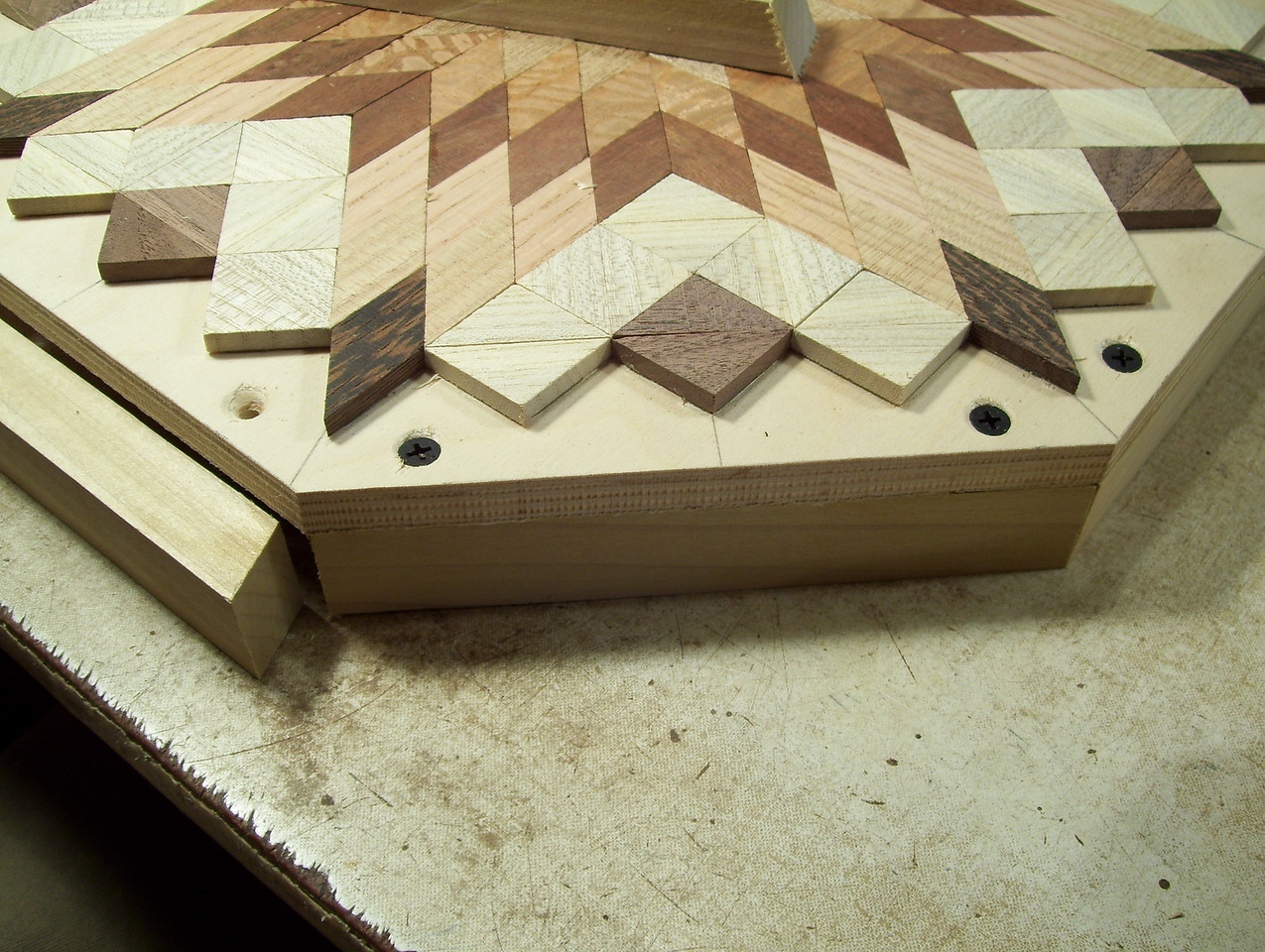 Making a Lazy Susan #30<br /> I now tilt the table on the foot powered table saw and cut the boards, one at a time, that will be glued and screwed around the edge of the lazy susan.