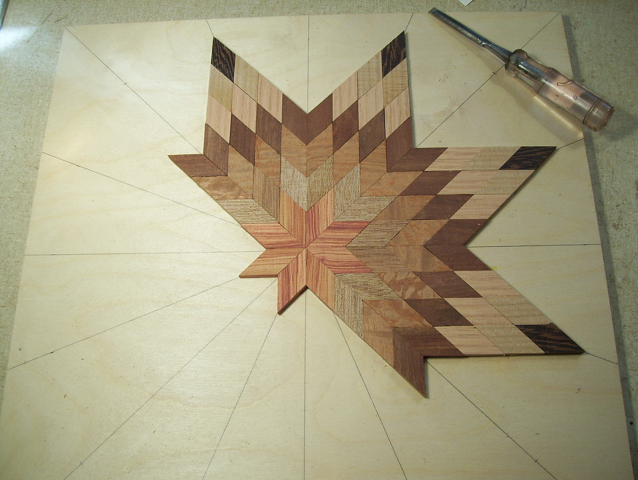 Making a Lazy Susan #11<br /> I continue this process one point at a time on around the star to the last two points.