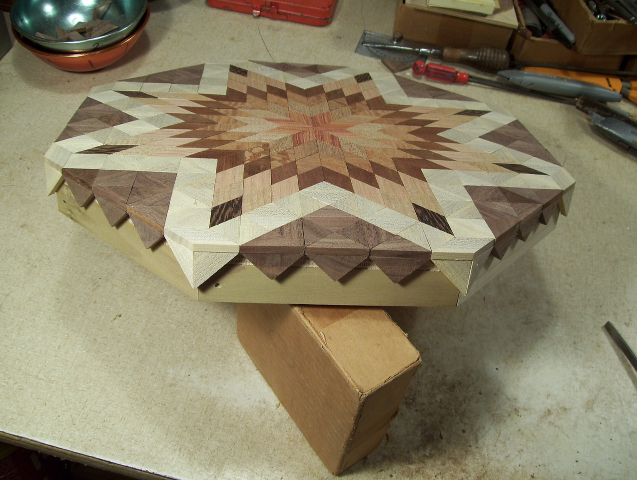 Making a Lazy Susan #43<br /> I then scrap off the excess glue that has squeezed out from these pieces.