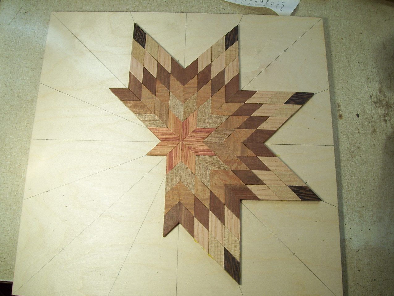 Making a Lazy Susan #12<br /> I continue this process one point at a time on around the star to the last two points.